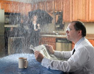 People in need of roof repair in Lake City GA. Leaky roof causing it to rain on people in their kitchen. Humorous.